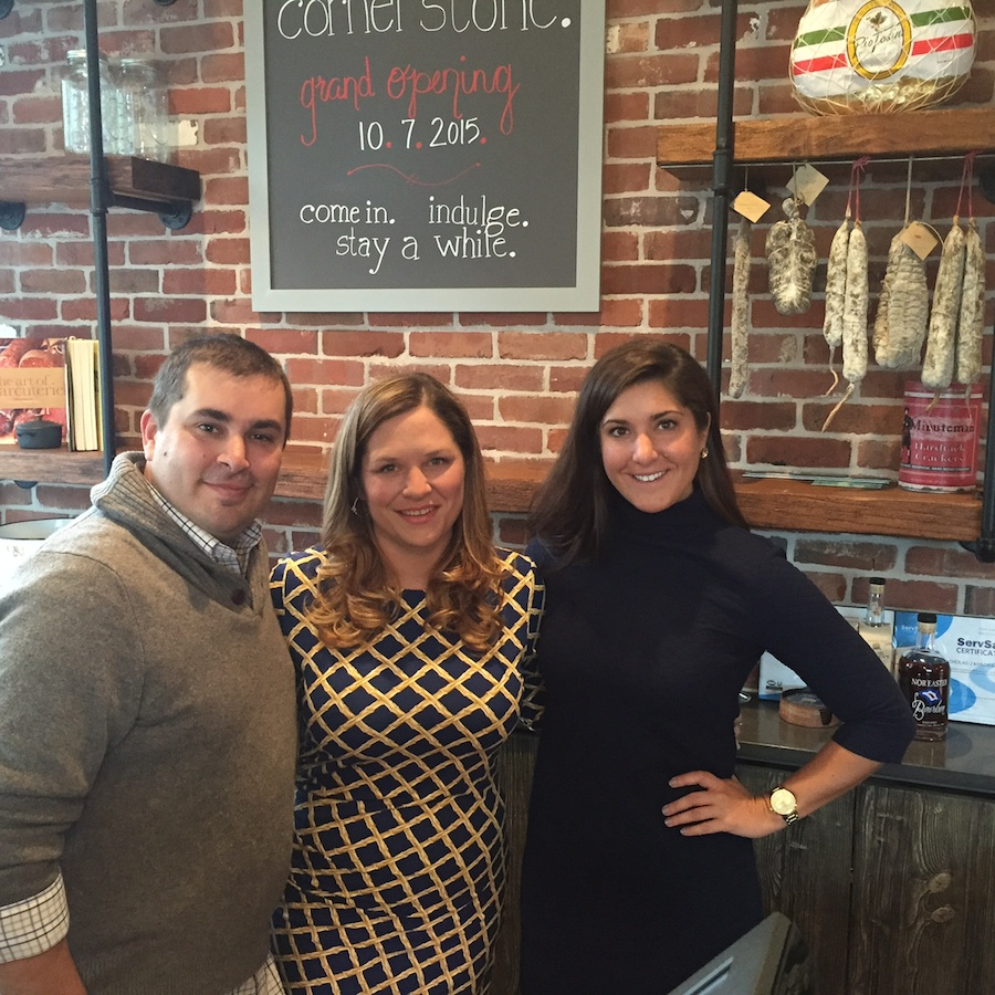 """Cornerstone owner/chef Christine Doherty Kondra (center), her husband, Nick, and General Manager, Allison Luchy. Christine calls the interior design """"industrial Northern California chic"""" with subway tiles, vintage brick wall, exposed wood beams and counter made from Kennett Square mushroom wood."""