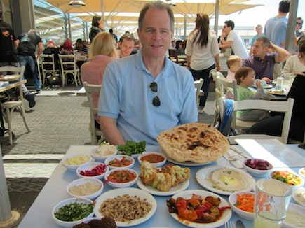 My husband, Rich, is ready to dig into the 18 salads and monster pita served to anyone lucky enough to snag a seat at the Old Man and the Sea in Jaffa Port.
