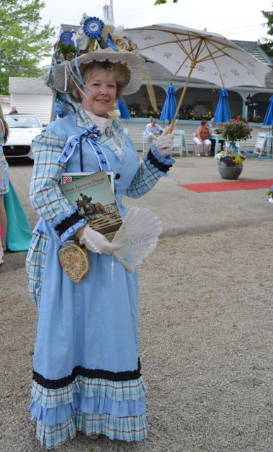 """Historical re-enactor, French teacher and first-time contestant, Pam Bastings adapted a 1880s/90s era gown, carried Devon history books and dolled up her hat with horsey chachkies to take the grand prize, """"Best in Show."""""""