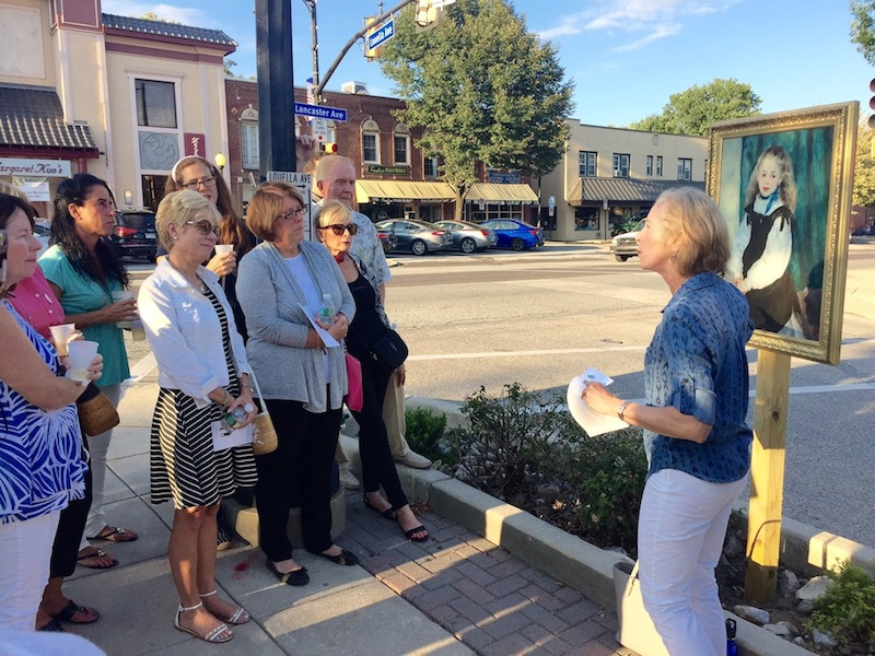 PMA guide and former Radnor H.S. art teacher Susan Wolf explains a Renoir at Lancaster and Louella Aves. during last week's kickoff art crawl.