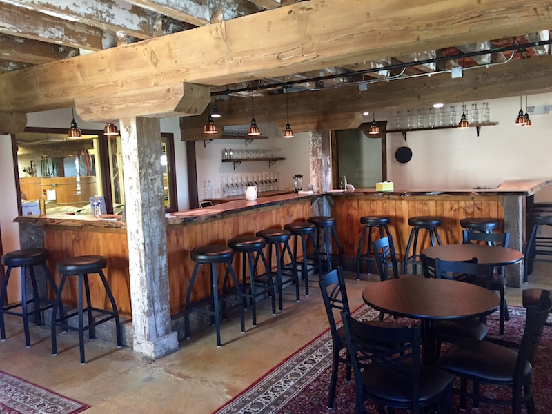 The cozy tasting room/bistro is outfitted with a hand-cut copper ceiling, bar and tables handcrafted from Main Line timber and soft seating.