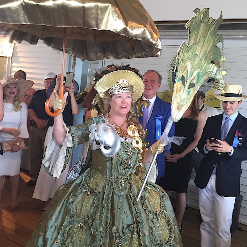 "And finally, Best in Show winner Pamela Bates, a West Chester French teacher, makes a grand entrance to collect her ribbon. Her costume: a custom ""Robe de la Francais"" gown with custom feathered headpiece."