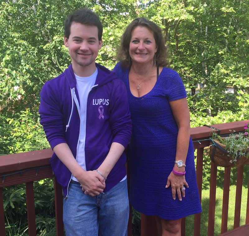 Scott and Betty Ann on their Berwyn deck wearing purple for lupus awareness.