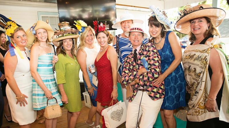 "Carson and the ""Best Group"" entry. Each hat showcased a scenes from Devon: Crissy Kelly (Trophies), Jo Standing Campbell (Lead Line), Miriam Volikas, June Smith (Lemon Sticks/Treats), Megan Van Dinderen (Grand Prix), Sue Arenschield (Grandstand), Carson Kressley, Kim Champy (Dixon Oval.) (Brenda Carpenter photo)"