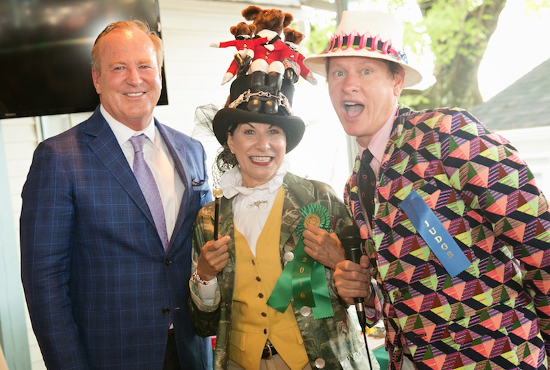 """""""Best of Devon"""" winner for her authentic equestrian ensemble, Lesley Brown enjoys her win with judges Michael Smyth of Jaguar/Land Rover Main Line and Carson Kressley."""