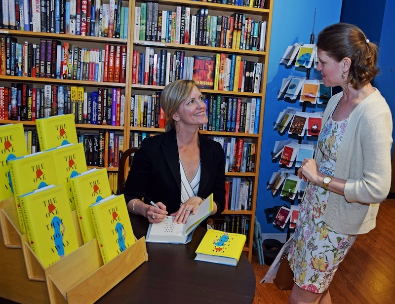 Author Leigh Himes signs a book for Rebecca Timme at Main Point Books.