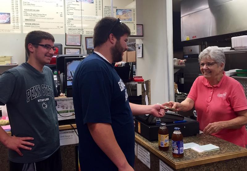 "Appetite's regulars Jimmy and Josh Pedorenko, AKA ""the reuben guys,"" pay Sonja for their final sandwiches."