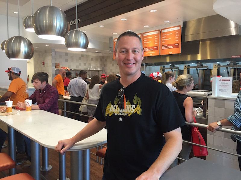 "CEO David Sloan at at the just-opened Naf Naf Grill in the new King of Prussia Town Center. With an open kitchen and bakery and meat roasted and cut in front of you, there are ""no surprises,"" he says."