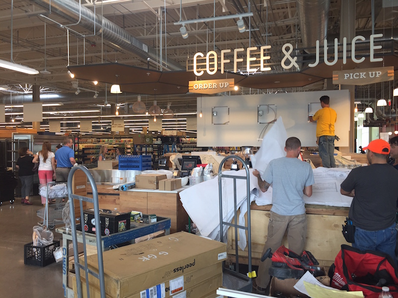 Workers prepare the Coffee & Juice Bar for Wednesday's opening.