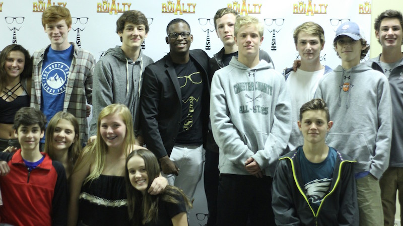 "LeRoi poses with students at his ""RoiAlty"" concert. The show was LeRoi's thank you to the T/E community that lifted him up through hard times. Proceeds were donated to sarcoma research in honor of his pal, Mark Herzlich, who famously beat sarcoma and now plays pro football."