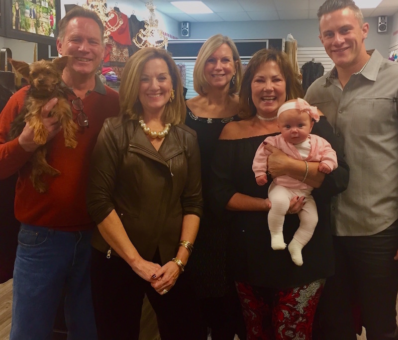 Polka Dots' co-owners Jim McCloskey (with store mascot, Gracie) and Ryan Randels (right), celebrate Susan Randel's enduring Polka Dots legacy with Susan's granddaughter McKenna and store managers Karen Denney, Lori Horning and Sheila Wagner.