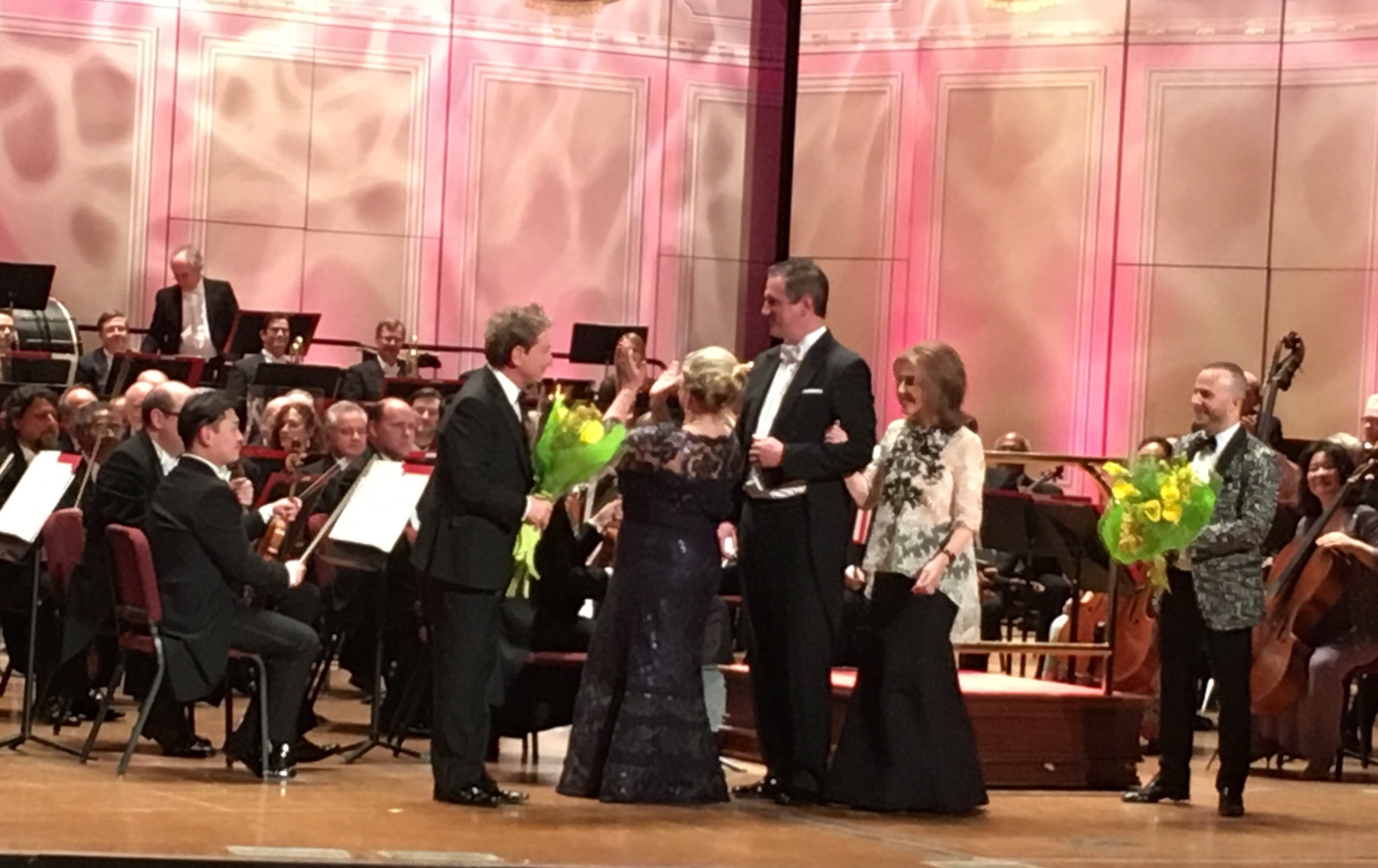 Martin Short accepts kudos and flowers from Academy Ball co-chair Georgiana Noll, and Adele Schaeffer, chair of the Academy of Music Board of Trustee, escorted by a member of the Young Friends Committee.