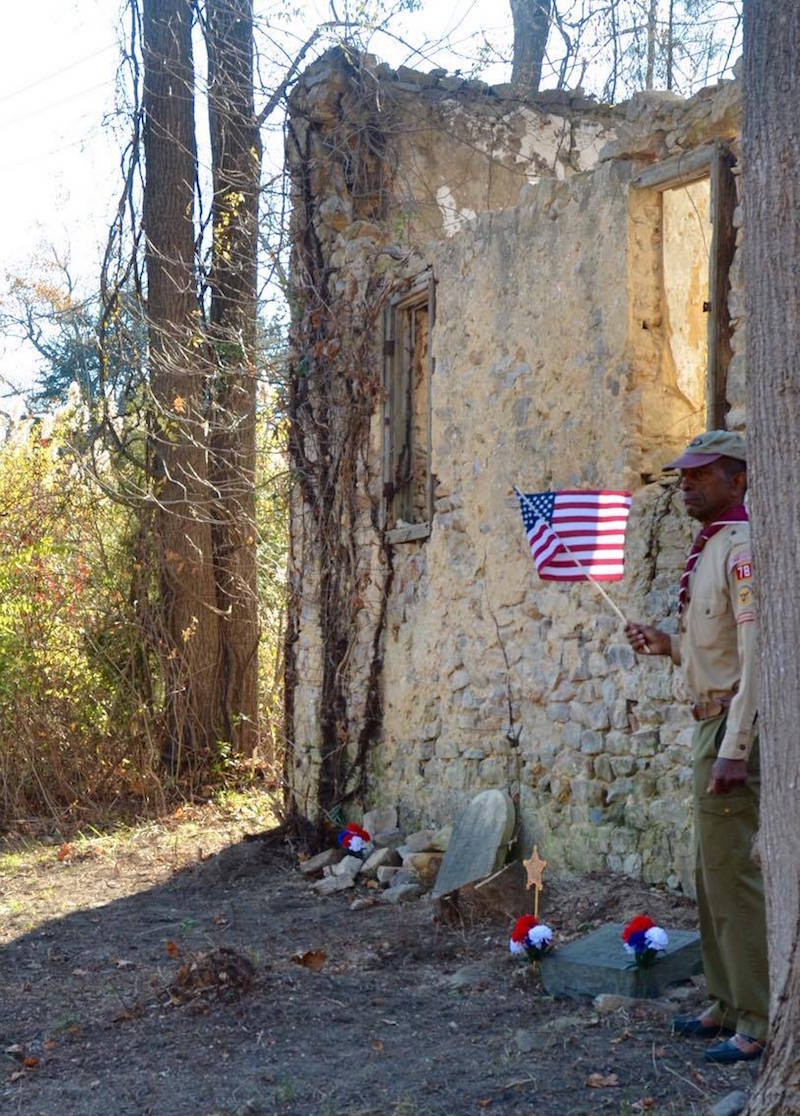 Al Terrell by the grave of Civil War soldier Joshua Johnson last November. Photo by Carla Zambelli.
