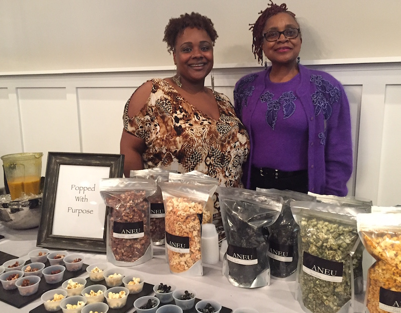 Exec. Chef Dorinda Hampton and her mother, Catherine, show off the house-made Popcorn with a Purpose.